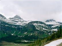 Wolke deckte Gebirgsgletscher-Nationalpark ab Lizenzfreie Stockbilder