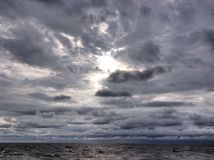 Wolke und Sonne Stockbild