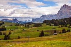 Wolken über Alpenwiesen Stockfotografie