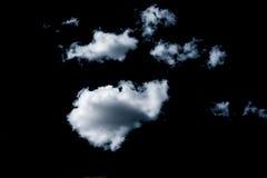 Wolken auf schwarzem Hintergrund Lizenzfreie Stockbilder
