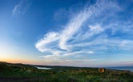 Wolken boven het eiland Stock Foto's