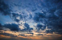 Wolken in de zonsonderganghemel Stock Afbeeldingen