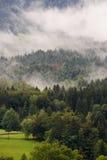 Wolken in den Alpen Stockfoto