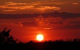 Wolken in der Orange bei Sonnenuntergang Lizenzfreies Stockbild