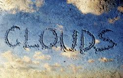 Wolken op een zand Stock Afbeeldingen