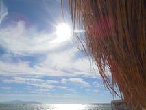 Wolken op het strand Stock Foto