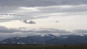 Wolken over Sneeuwbergen Timelapse stock videobeelden