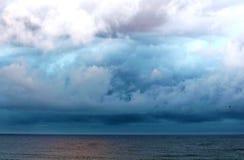Wolken-Ozean-Sand Lizenzfreie Stockbilder