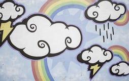 Wolken und Regenbogen Lizenzfreie Stockfotos