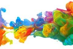 Wolken van heldere kleurrijke inkt Stock Foto
