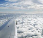 Wolken van Vliegtuig worden gezien dat Stock Foto's