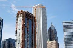 Wolkenkrabber in bouw stock foto's
