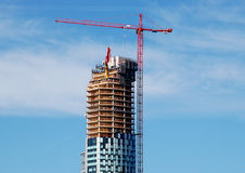 Wolkenkratzer-Aufbau-Kran Stockbild