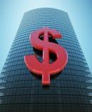 Wolkenkratzer mit rotem Dollarzeichen Lizenzfreies Stockbild