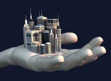 Wolkenkratzer-Stadt in der Palme einer Hand Lizenzfreie Stockfotografie
