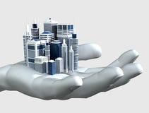 Wolkenkratzer-Stadt in der Palme einer Hand Lizenzfreies Stockfoto