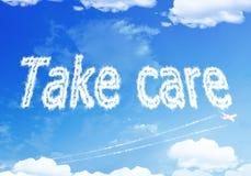Wolkentext: WENDEN Sie SORGFALT auf dem Himmel an Lizenzfreies Stockbild