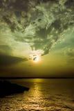 Wolkenvorming over zonsondergang Stock Foto