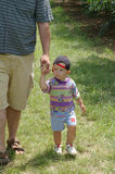 Wolking with father. Toddler boy is walking with father on the farm stock photos