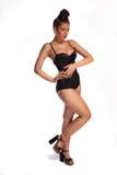 Wollüstige Frau in einem Badeanzug und in den Fersen Lizenzfreies Stockfoto