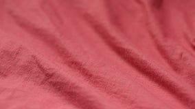 Wolny panning strzelał czerwona tkanina od poliesteru i bawełny zbiory