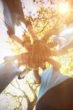 Wolontariuszi tworzy ręki stertę w parku fotografia stock