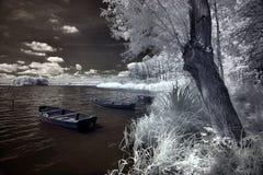 Wolsztyn lake. Boats and Wolsztyn lake in Poland, Poland. The infrared image Royalty Free Stock Photo