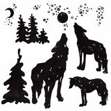 Wolves howling at the moon. Silhouettes Royalty Free Stock Images