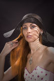Woma in a black hat Stock Photos