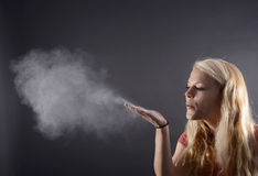 Woma blowing powder Stock Photo