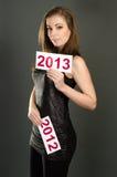 Woma con la escritura de la etiqueta 2012 y 2013 Imágenes de archivo libres de regalías