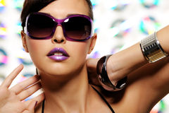 Woma in fashion sunglasses. Portrait of expressive beautiful young woman with stylish sunglasses Stock Photos