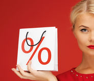 Woma????? with shopping bag. Picture of lovely woman in red dress with shopping bag Royalty Free Stock Image