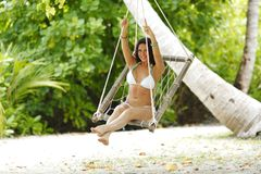 Womain in beach hammock Royalty Free Stock Photos