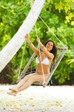 Womain in beach hammock Stock Image