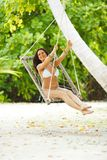Womain in beach hammock Stock Photo