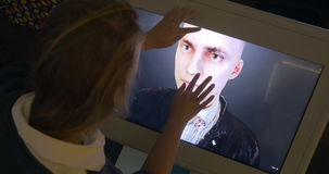Womam looking at 3D human model on touchscreen stock video footage
