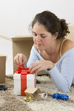 Womam prepare a gift Royalty Free Stock Image