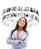 Womaman di affari sembrando i bottoni virtuali Fotografie Stock Libere da Diritti