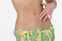 Woman′s belly and hand royalty free stock photography