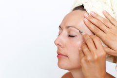 Woman's eyebrows being plucked. Eyebrows being plucked in a beauty spa royalty free stock photography