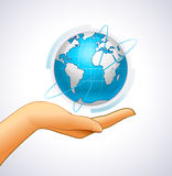 Woman's hand is holding small earth Stock Image