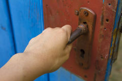 Woman's hand open old wooden door Royalty Free Stock Photography