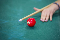 Woman's hands on a billiard table. Playing Royalty Free Stock Image