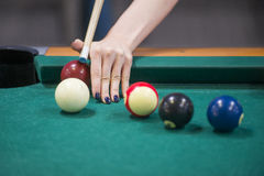 Woman's hands on a billiard table. Playing stock photo