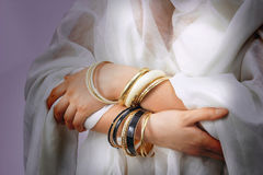 Woman's hands with golden bracelets royalty free stock photos