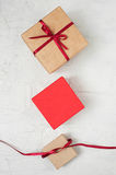 Woman's hands knotted red bow on the gift box Stock Photography