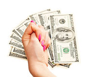 Woman's hand shows fig on money background Stock Photography