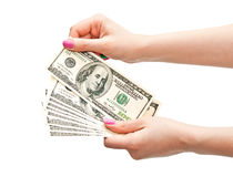 Woman's hands counting 100 US dollar banknotes Royalty Free Stock Photography