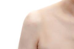 Woman& x27; плечо s на белой изолированной предпосылке Стоковые Фотографии RF